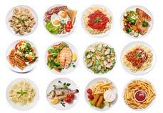 Różnorodni talerze odizolowywający na białym tle jedzenie, odgórny widok obrazy stock