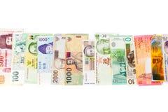 Różnorodni waluta banknoty odizolowywający na bielu obraz stock