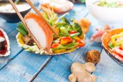 Różnorodny azjatykci posiłki na nieociosanym tle Zdjęcie Stock