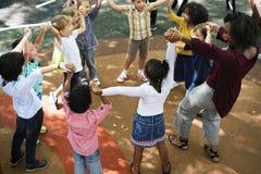 Różnorodny dzieciniec żartuje ręki podnosić fotografia stock