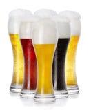 Różny świeży piankowaty piwo w szkłach Zdjęcie Royalty Free