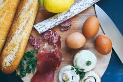 Różny jedzenie na kuchennej drewnianej desce widok od wierzchołka Obraz Stock