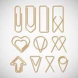 Różny typ złociste papierowe klamerki Fotografia Stock