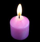 Różowa świeczka w ciemność zdjęcie stock