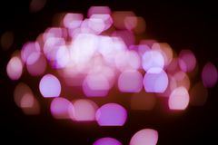 Różowa błyskotliwość zaświeca tło defocused zdjęcia stock
