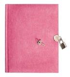 Różowa dzienniczek książka z kędziorkiem i kluczem Zdjęcie Stock