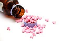 Różowe medycyn pigułki Zdjęcia Stock