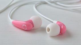 Różowe słuchawki zdjęcie stock