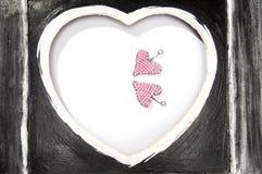 Różowi serca w czerni ramie Zdjęcie Royalty Free