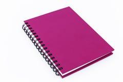 Różowy notatnik odizolowywający zdjęcia royalty free