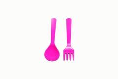 Różowy plastikowy rozwidlenie i łyżka Zdjęcie Royalty Free