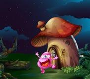 Różowy potwór blisko pieczarkowego domu Obrazy Royalty Free