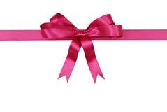 Różowy prezenta łęku i faborku prosto horyzontalny odosobniony na białym tle horyzontalnym Obraz Stock