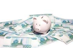 Różowy prosiątko bank z banknotem fotografia royalty free