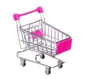 Różowy wózek na zakupy odizolowywający na białym tle Fotografia Stock