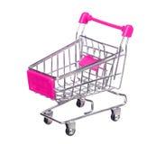 Różowy wózek na zakupy odizolowywający na bielu Obrazy Royalty Free