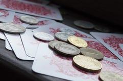 Różnorodne monety i karta do gry Zdjęcie Royalty Free