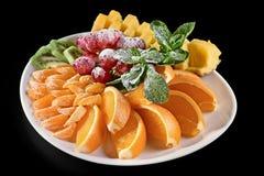 Różnorodni typ cytrus owoc na ciemnym tle Zdjęcia Stock