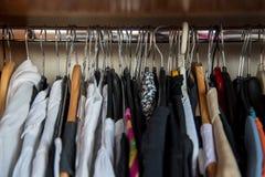 Różnorodny odziewa w garderobie Fotografia Stock