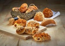 Różny chleb na Drewnianym tle Obrazy Royalty Free