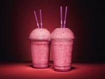 Różowi smoothies na czerwieni - Akcyjny wizerunek zdjęcie royalty free