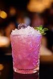 Różowy koktajl przy barem Fotografia Royalty Free
