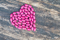 Różowy serce na drewnianym tle Obrazy Royalty Free