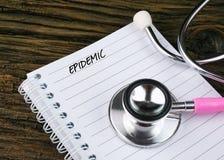 Różowy stetoskop I Otwarty notatnik Z tekstem Zdjęcie Stock