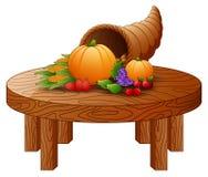 Róg obfitość z warzywami i owoc na round drewnianym stole ilustracji