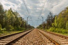 Równolegli kolejowi ślada i zasięrzutne linie Obraz Royalty Free