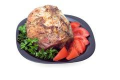 Rôtissez dans les épices avec des parts de tomate Photographie stock