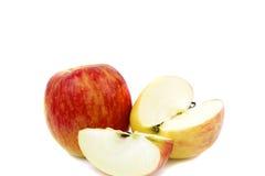 Röd äpple och halvt Arkivfoto