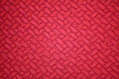 Röd abstrakt bakgrunds- eller rastermodelltextur Royaltyfri Bild