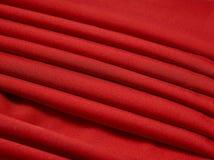 Röd abstrakt torkduk, tygbakgrund och textur, gardinteater Arkivbilder