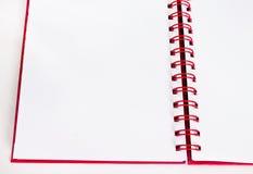 Röd anteckningsbok Royaltyfri Bild