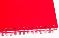 Röd anteckningsbok Arkivfoto