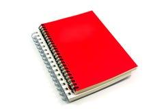 Röd anteckningsbokCove Arkivbild