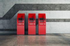 Röd ATM i konkret inre Arkivbild