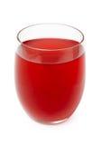 Röd bärfruktsaft i exponeringsglas Arkivbild