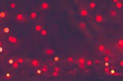 Röd bakgrund för bokehtexturjul Arkivbilder