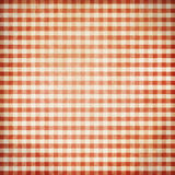 Röd bakgrund för grungepicknickbordduk Royaltyfri Bild