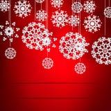 Röd bakgrund för jul med snöflingamodellen. Arkivbilder