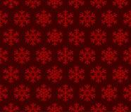 Röd bakgrund för snöflingor med den sömlösa modellen Arkivfoton