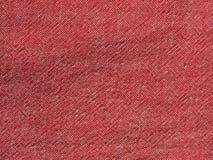 Röd bakgrund för textur för bomullstyg arkivfoto