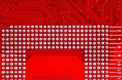 Röd bakgrund för textur för strömkretsbräde av datormoderkortet Royaltyfri Fotografi