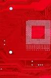 Röd bakgrund för textur för strömkretsbräde av datormoderkortet Royaltyfri Bild