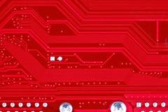 Röd bakgrund för textur för strömkretsbräde av datormoderkortet Royaltyfria Foton