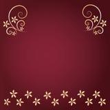 Röd bakgrund med den guld- blomman Arkivfoto