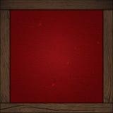 Röd bakgrund med den wood ramen Arkivbild