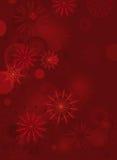 Röd bakgrund med fina snowflakes Arkivfoto